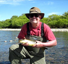 Jim Dufresne with a brown trout.