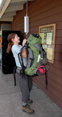 Weighing a backpack at Rock Harbor