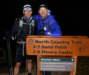 Eric Carlson (left) and Roy Kranz at the end of their 35-hour, 84-mile trek.