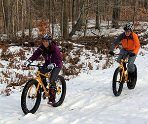 Fat tire bikers following a trail at Crystal Mountain Resort.