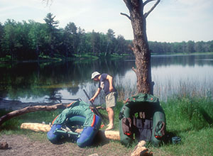 A belly boat angler sets up his equipment at Byron Lake in the Hoist Lakes Foot Travel Area.