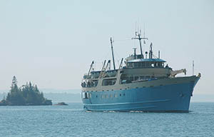 The Ranger III pulling into Rock Harbor at Isle Royale National Park.