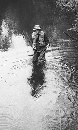 Art Neumann, a founding father of Trout Unlimited, fishing on the Rifle River.